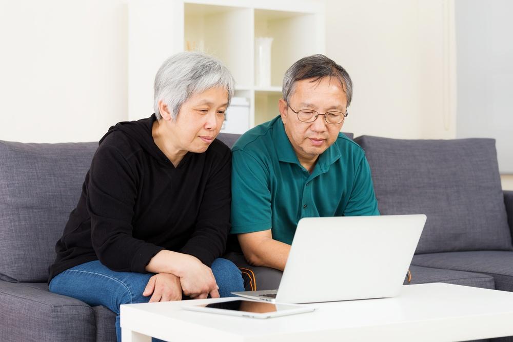 Asian old couple using laptop.jpeg