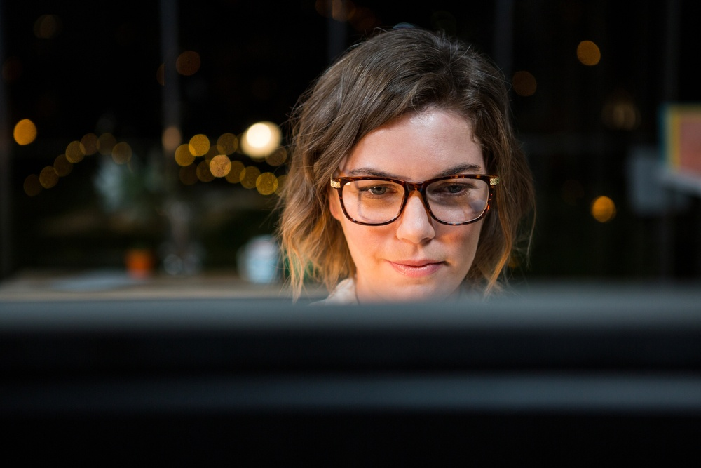 Close-up of businesswoman working on computer at her desk in the office.jpeg