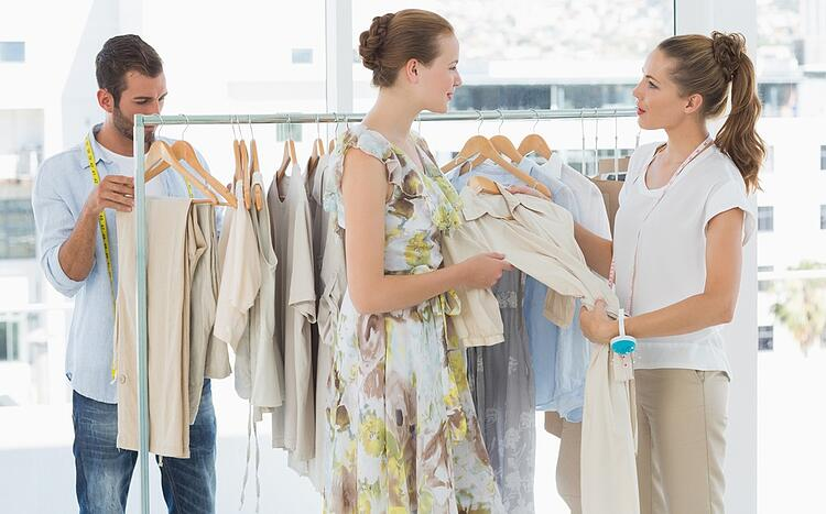 Female seller helping shopper choose the clothes in the store.jpeg