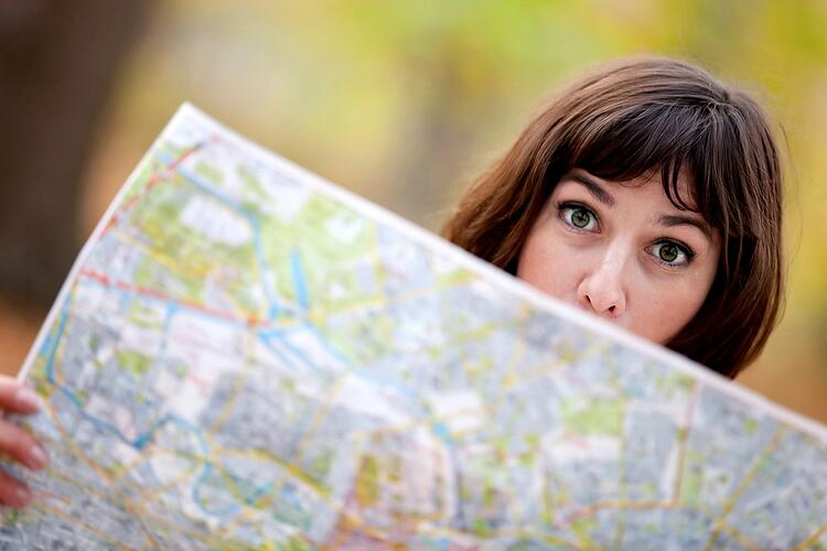 Lost woman in the countryside holding a map.jpeg