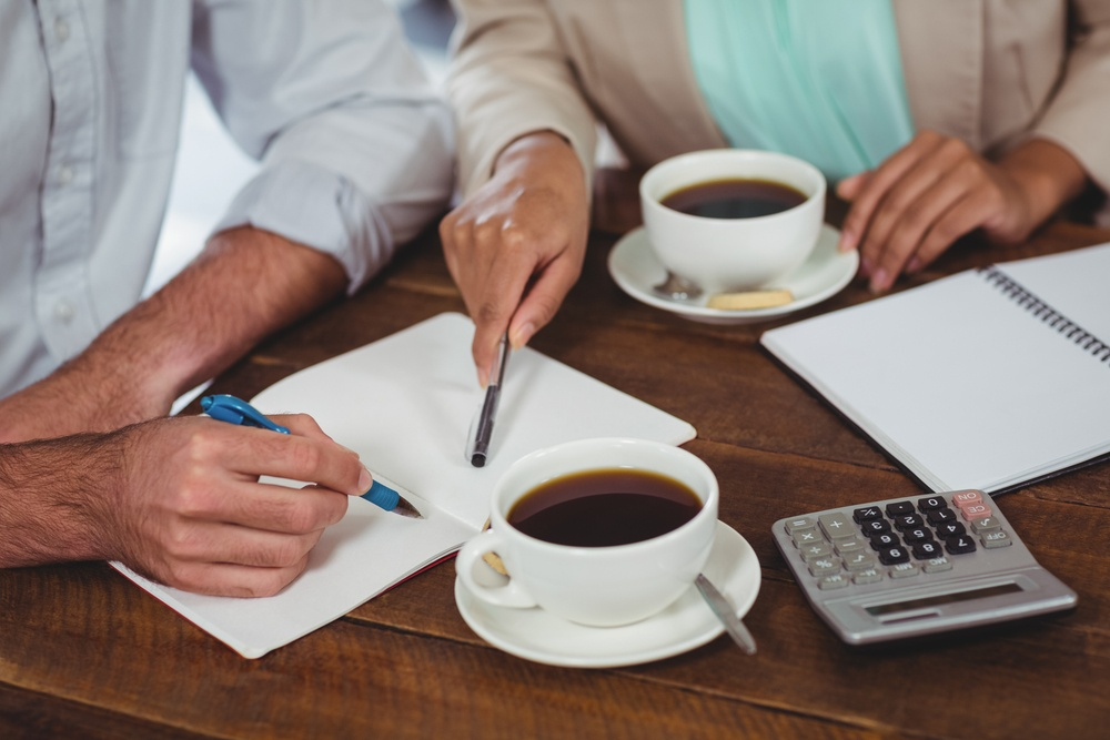 Man and woman meeting over coffee in restaurant-1