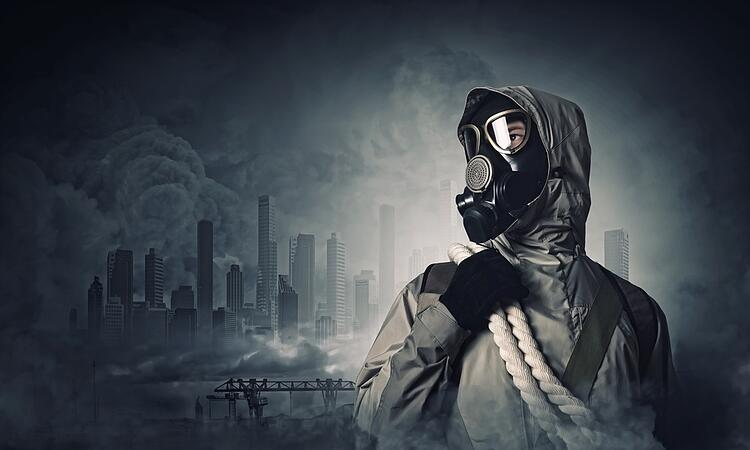 Man in gas mask against disaster background. Pollution concept.jpeg