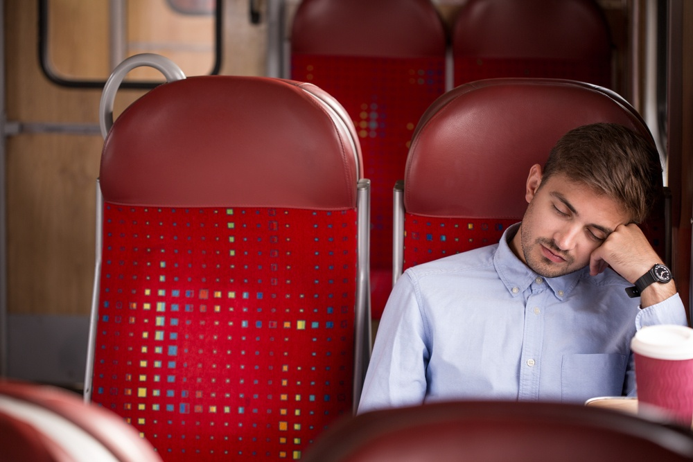 Photo of tired commuter going home after work