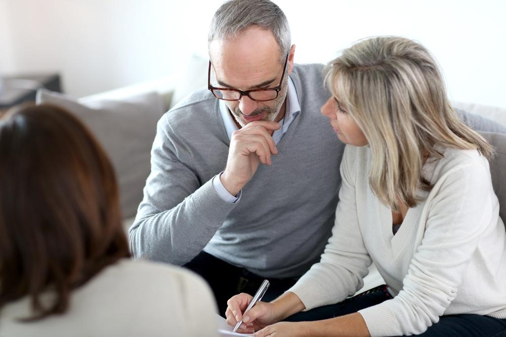 Senior couple meeting financial adviser for investment.jpeg
