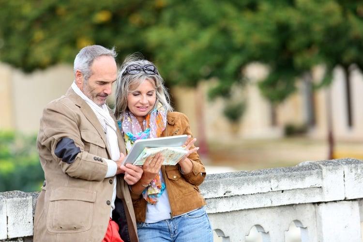 Senior couple of tourists on a trip.jpeg