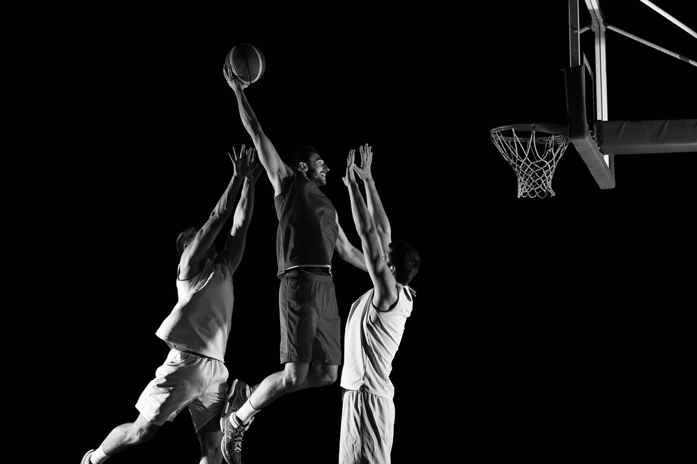 basketball game sport player in action isolated on black background.jpeg