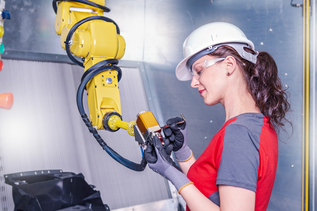 a-young-female-technician-while-machine-constructing-in-a-manufacturing-plant_t20_09WJdw