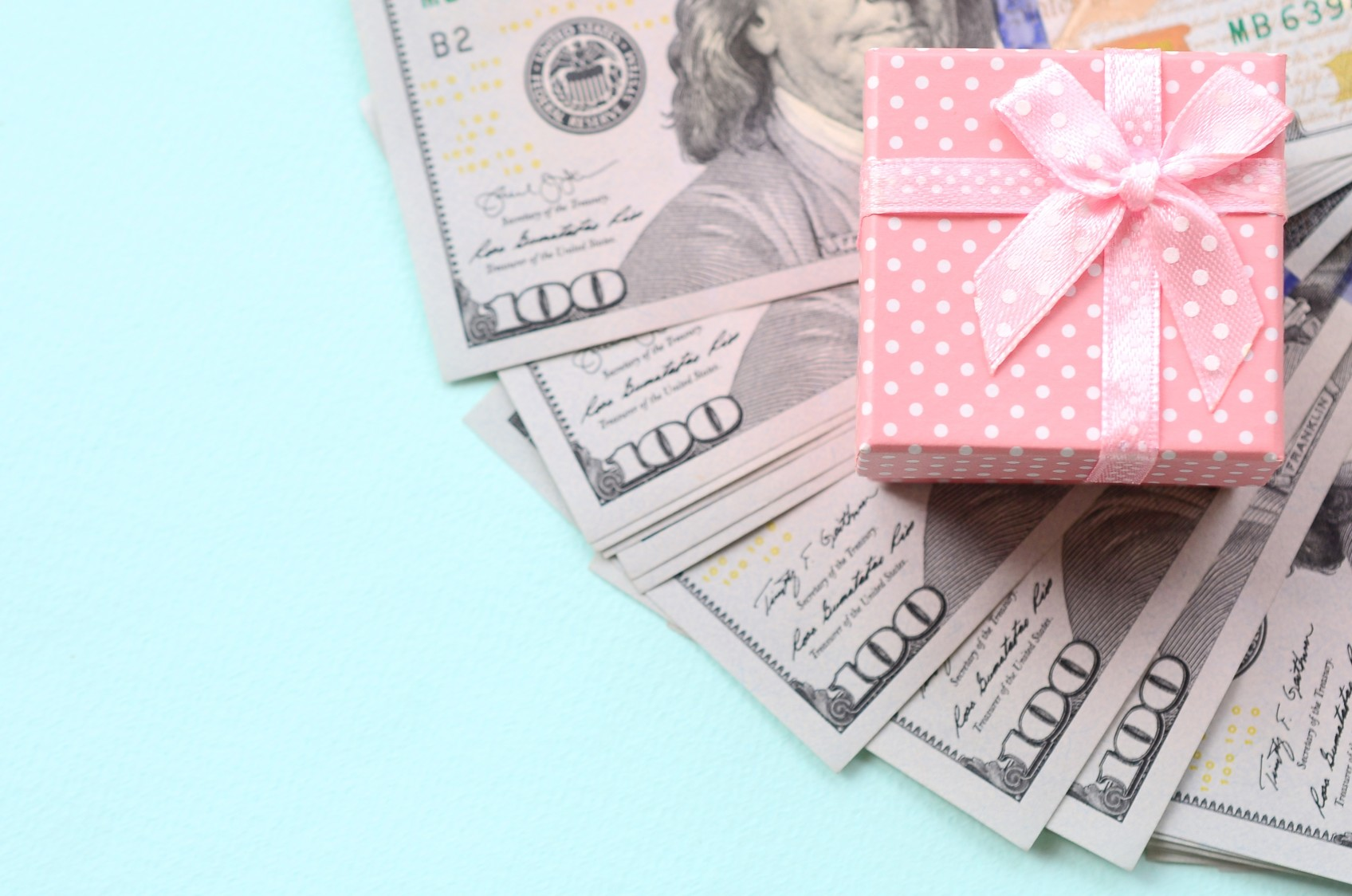 money-gift-box-dollar-cash-bow-white-isolated-present-bill-hundred-paper-currency-finance-ribbon_t20_RzAP8J
