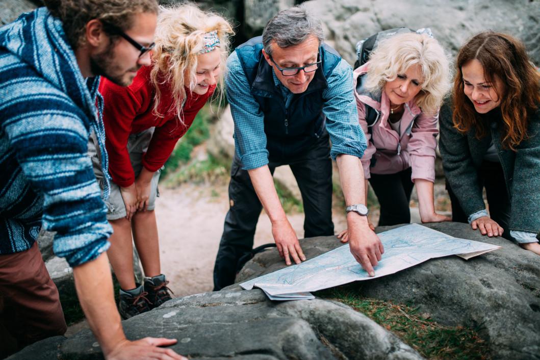 people-sport-fun-hiking-tourism-map-rocks-group-hike-guide_t20_2JKYQO