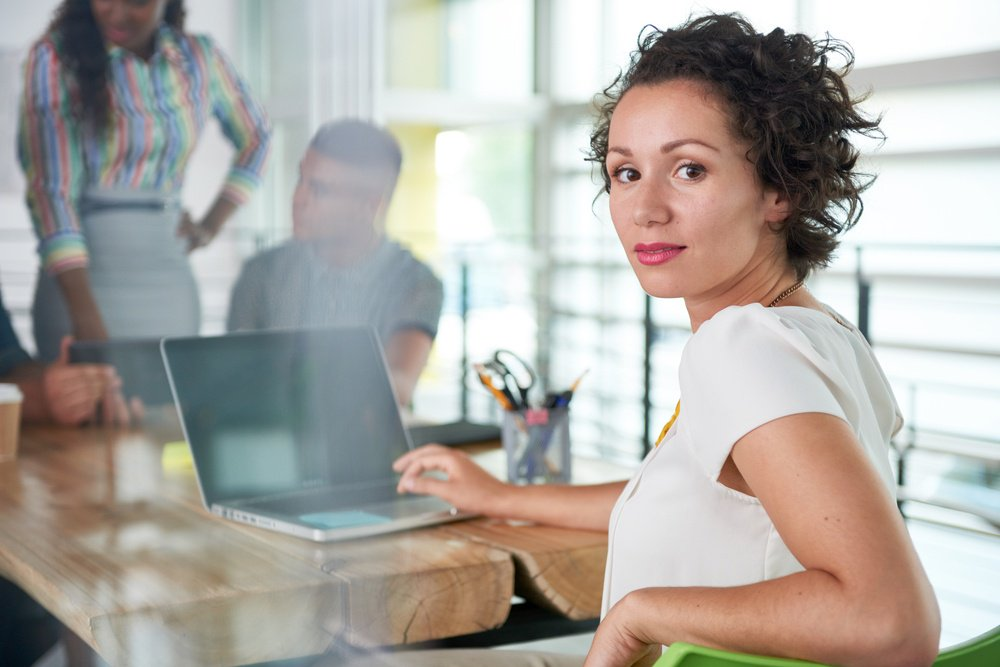 Image of a succesful casual business woman using laptop during meeting-2-6