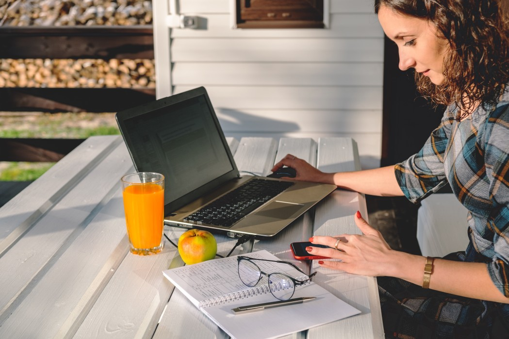 young-businesswoman-working-on-laptop-from-home-office-freelance-woman-using-mobile-technologies_t20_mR0zjr